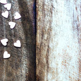 Valentines Day background with candy hearts. Sugar Hearts on woo Stock Photo
