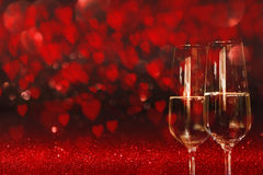 Valentines Day Background with champagne. Valentines day background with a sky full of red heart and two glass of champagne for a concept Royalty Free Stock Photography