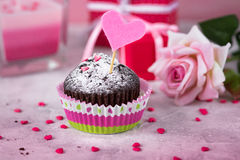 Valentines day background. Chocolate cupcake, gift and flower. Stock Photography