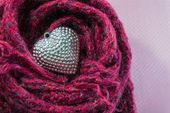 Valentines Day background with Close up Silver heart on scarves. Stock Photos