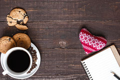 Valentines day background. coffee cup with knitted heart, blank notebook Royalty Free Stock Photos