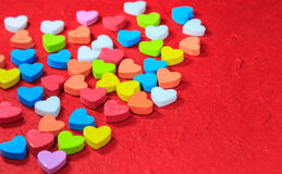 Valentines day background with colorful heart shaped on red pape Stock Images
