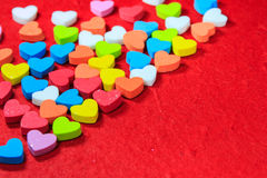 Valentines day background with colorful heart shaped on red pape Stock Image