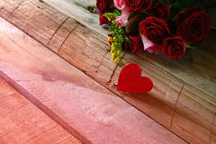 Valentines day background. Couple of red hearts and roses Stock Photos