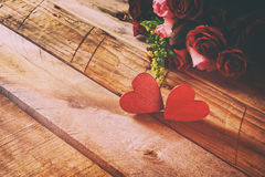 Valentines day background. Couple of red hearts and roses Stock Images