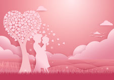 Valentines day background. Couple standing under tree of love Stock Image