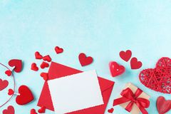 Valentines day background. Envelope, greeting card, gift box and red hearts for holiday message stock images