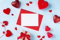 Valentines day background. Envelope, greeting card, gift box and red hearts for holiday message. Valentines day background. Envelope, greeting card, gift box and stock photos
