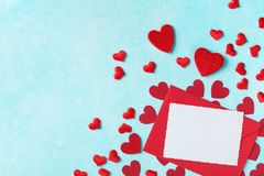 Valentines day background. Envelope, greeting card and red hearts for holiday message royalty free stock photo