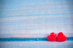 Valentines Day background with Fabric valentine heart on grunge wood table.Retro filter Royalty Free Stock Images