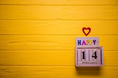Valentines day background with February 14 and red heart. Day 14 of February set on wooden calendar royalty free stock photography