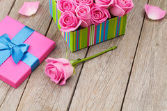 Valentines day background with gift box full of pink roses Stock Images