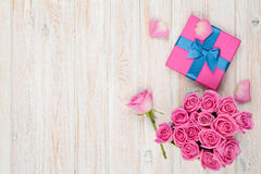 Valentines day background with gift box full of pink roses. Over wooden table. Top view with copy space Royalty Free Stock Photos