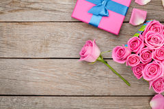 Valentines day background with gift box full of pink roses Royalty Free Stock Photos