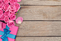 Valentines day background with gift box full of pink roses Stock Photography