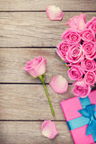 Valentines day background with gift box full of pink roses Stock Photos