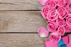 Valentines day background with gift box full of pink roses Stock Photo
