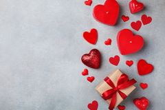 Valentines day background with gift box and red hearts stock image