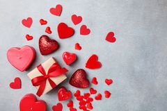 Valentines day background with gift box and red hearts stock photo