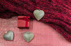 Valentines Day background with gift box Silver heart and scarves Stock Image