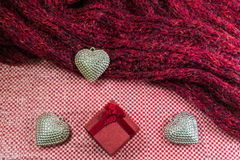 Valentines Day background with gift box Silver heart and scarves Stock Images