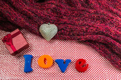 Valentines Day background with gift box Silver heart, scarves an Stock Photography