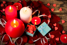 Valentines day background with gift boxe, candle, rose petals, red heart Stock Image