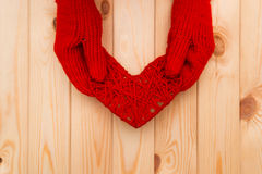 Valentines Day background. Girl in mittens gives a heart Stock Photography