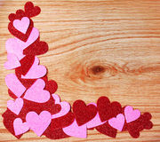 Valentines Day background. Glitter Red and Pink Hearts on Wooden Stock Images