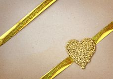 Valentines day background, golden heart made of beads, gold rib Royalty Free Stock Photo