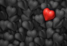 Valentines Day Background. With a group of grey hearts and one red shiny heart as a valentine symbol for romance and passion Royalty Free Stock Photography