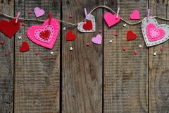 Valentines Day background with handmade felt hearts, clothespins. Valentine gift making, diy hobby. Romantic, love concept. Happ royalty free stock photo