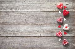 Valentines day background with handmade textile hearts royalty free stock photography