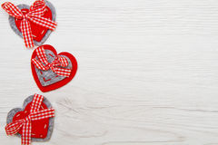 Valentines day background with handmade toy hearts over wooden t Royalty Free Stock Images