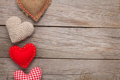Valentines day background with handmade toy hearts. Over wooden table Stock Images