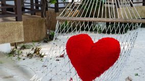 Valentines day background with handmade toy hearts. Over wooden table. Hammock stock video