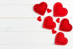 Valentines day background with handmade toy hearts on wooden table.  Royalty Free Stock Photos