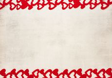 Valentine`s Day February 14th is a stylish minimalistic light gray cement background with a frame of red hearts from above and royalty free stock photo