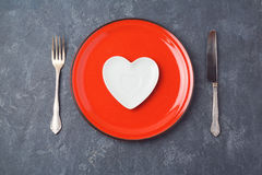 Valentines day background with heart shape plate. Restaurant dinner or menu concept. View from above stock image