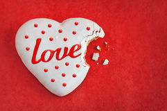 Valentines day background - heart shaped cookie on red Stock Photo