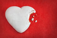 Valentines day background - heart shaped cookie on red Stock Photos