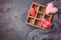 Valentines day background with heart shapes in wooden box. Royalty Free Stock Photo