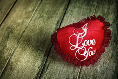 Valentines day background with heart on wood background . Stock Images