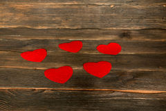 Valentines day background with hearts. Dark wooden ba. Ckground Stock Photo
