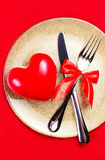 Valentines Day background with hearts on a golden plate over red Royalty Free Stock Image
