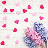 Valentines Day background with hearts and hyacinth flowers on white tablecloth. Royalty Free Stock Photography