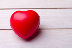Valentines Day background with hearts. Red heart on wooden background stock photo