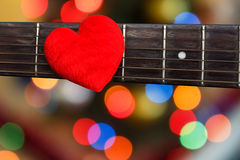 Valentines Day background with hearts on vintage guitar. For background royalty free stock photo