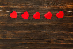 Valentines day background with hearts. wooden background. Valentines day background with hearts. Dark wooden background Stock Image