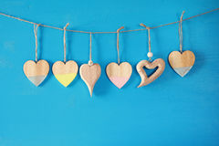 Valentines day background. hearts on wooden background Stock Photos